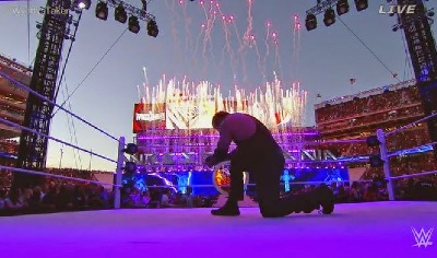 The Undertaker kneelng as dusk fell was eerily awesome