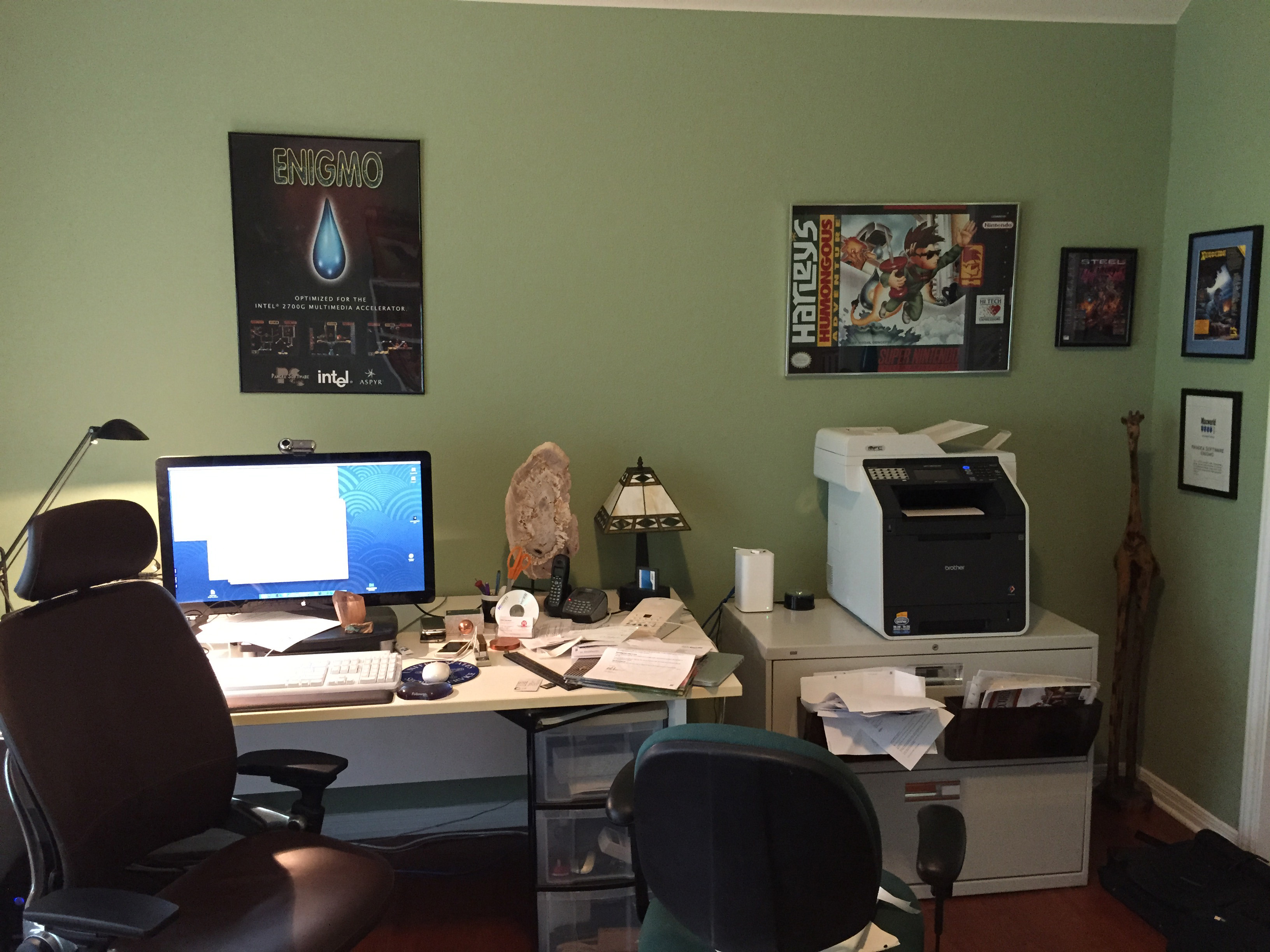 Brian's office proudly displays the Harley poster