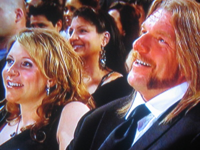 Triple H and his wife Stephanie McMahon laugh