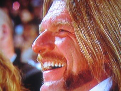 Triple H laughs along with the crowd