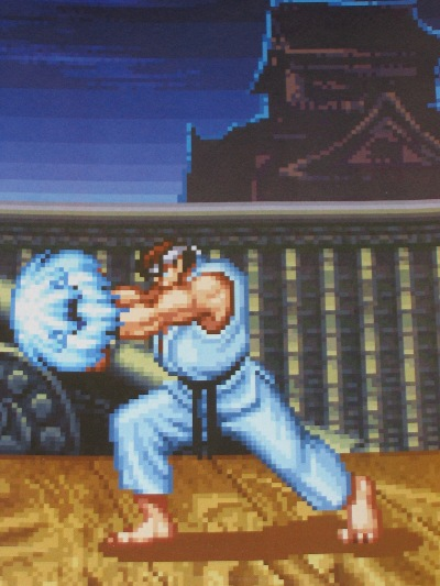 You can't go wrong with any SNES Street Fighter!