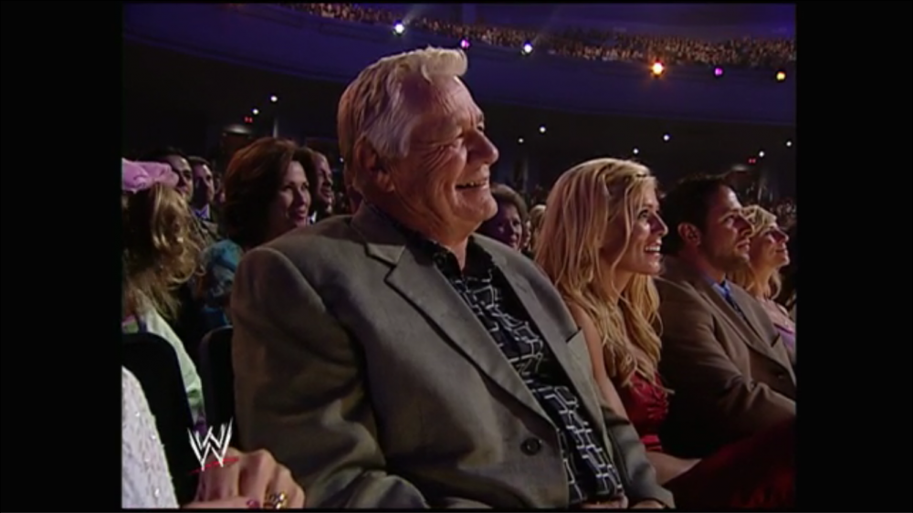 Pat Patterson and Torrie Wilson laugh
