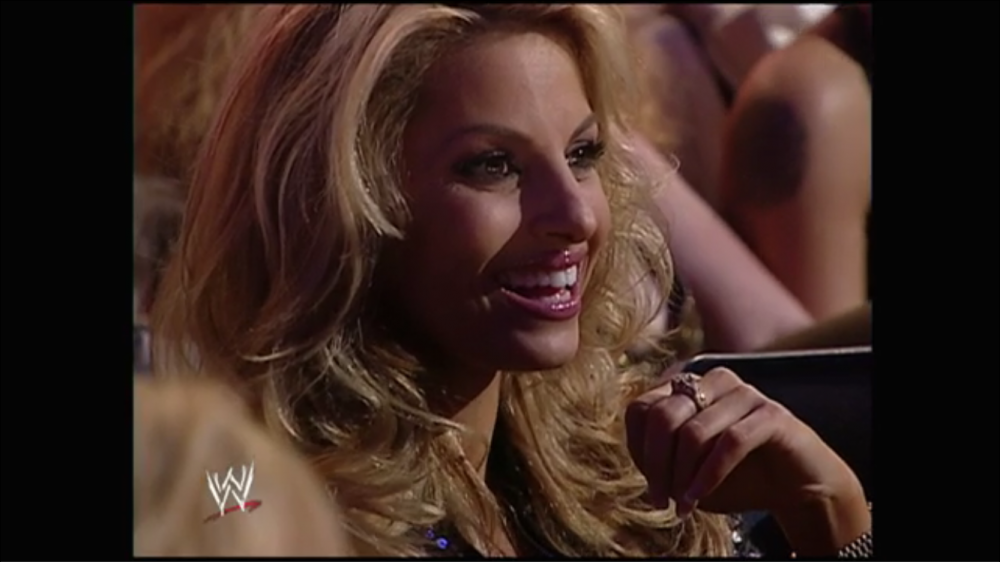 Trish Stratus laughs as the crowd groans a bit