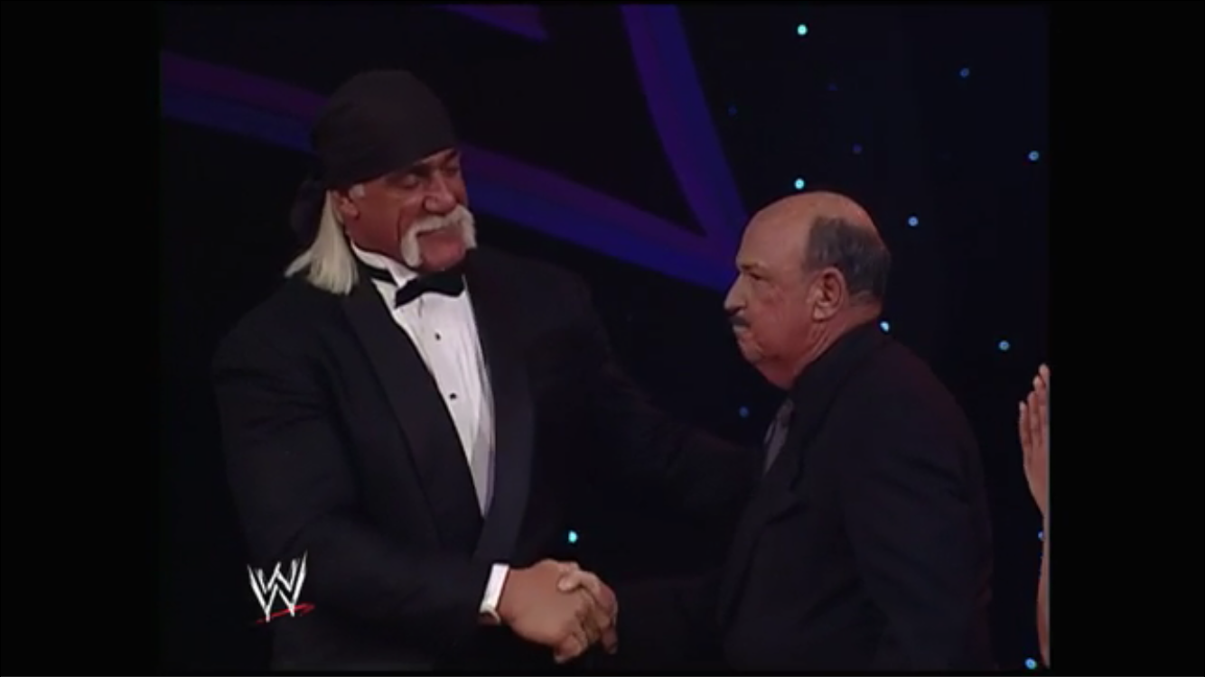 Hogan and Mean Gene embrace again