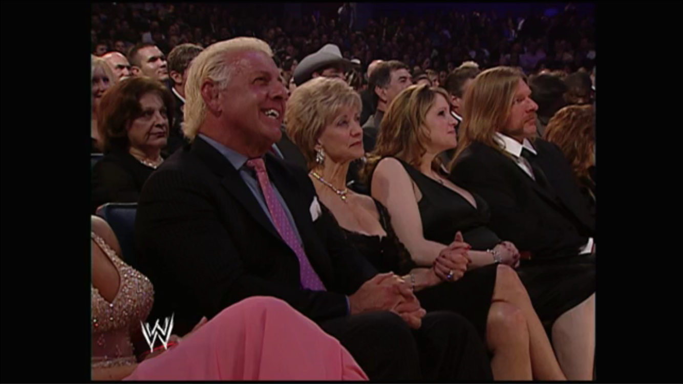 Ric Flair, the McMahons and Triple H look on