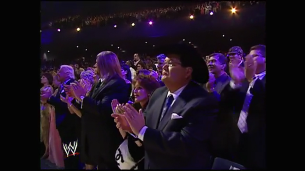 Jim Ross and friends stand up to applaud Mean Gene