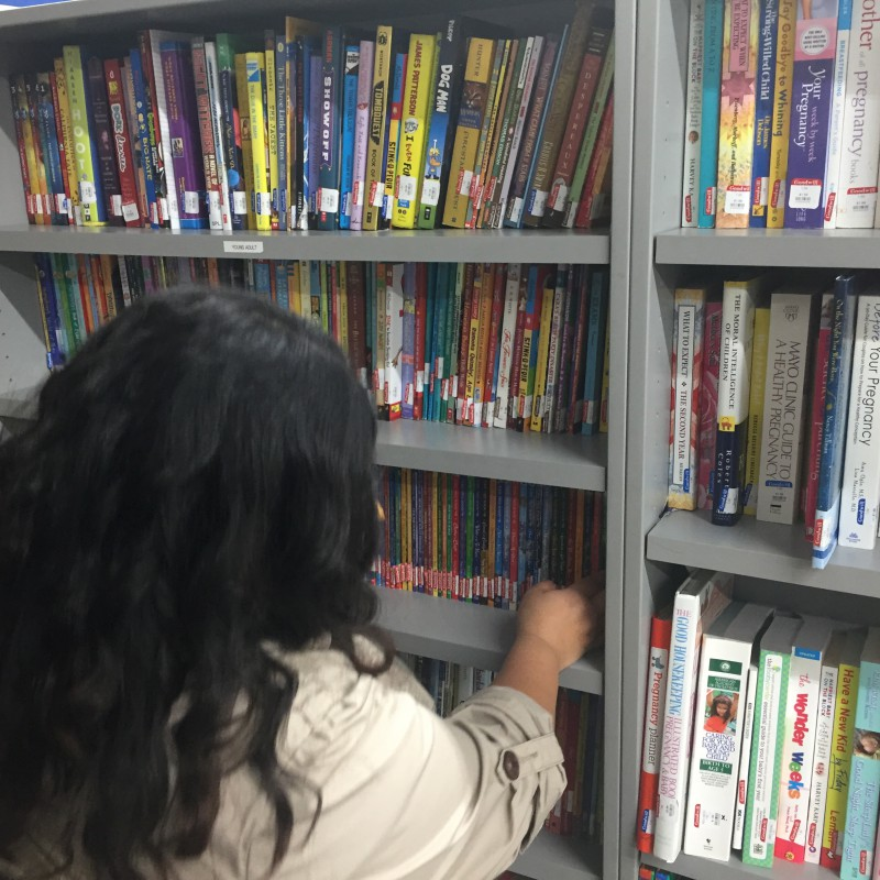 My girlfriend checking out the goods. Major props to her for putting up with my book fever